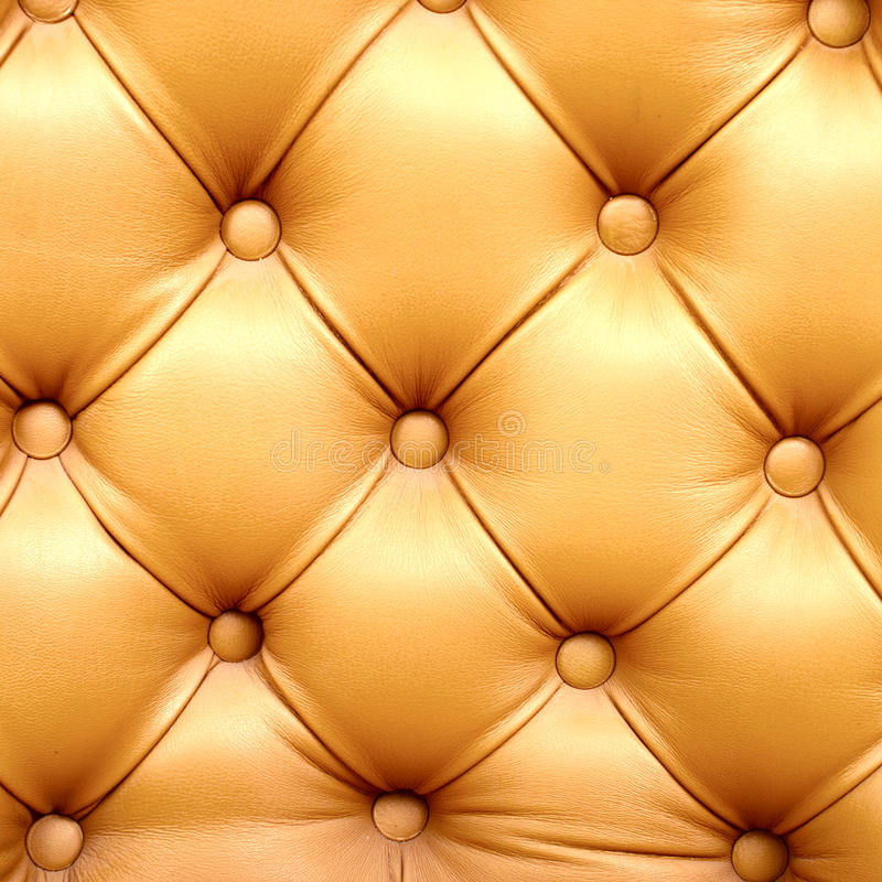 Upholstery sofas. Beautiful leather upholstery sofa with buttons royalty free stock photo