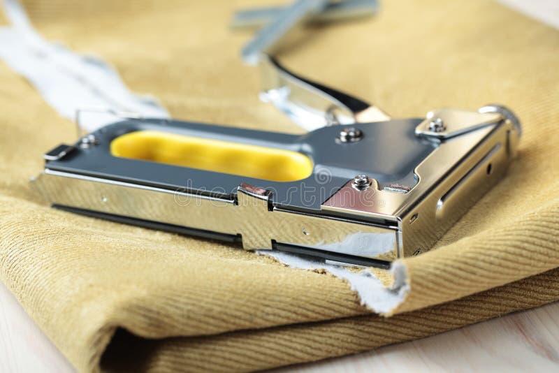 Upholstery stapler stock photography