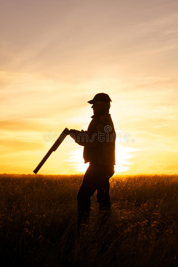 Hunter in Sunset stock photography