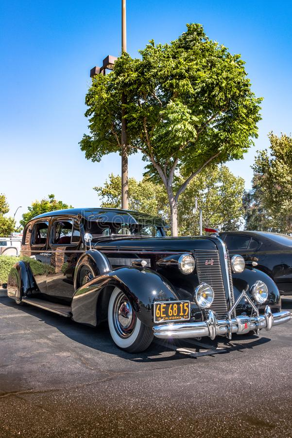 1937 Buick 8 - Black - Front Quarter. Upland, United States of America - July 29, 2017: 1937 Black Buick 8 Special appears in spontaneous classic car show in stock images