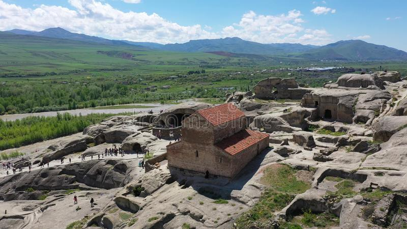 Uplistsikhe is an ancient rock-hewn town in eastern Georgia. Aerial view royalty free stock photo