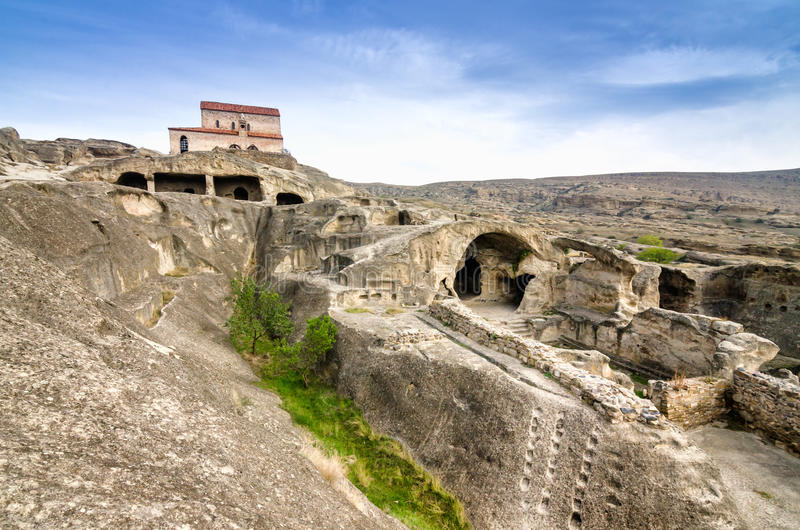 Uplistsikhe is an ancient rock-hewn town in eastern Georgia,. Some 10 kilometers east of the town of Gori, Shida Kartli. It is one of the first cities on the royalty free stock photo