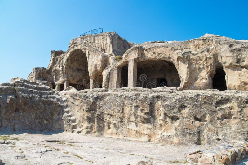 Uplistsikhe forntida vagga-huggen ut stad och grottor - lordsfästningen från tidig järnålder till mellersta åldrar nära Gori - äl royaltyfria foton