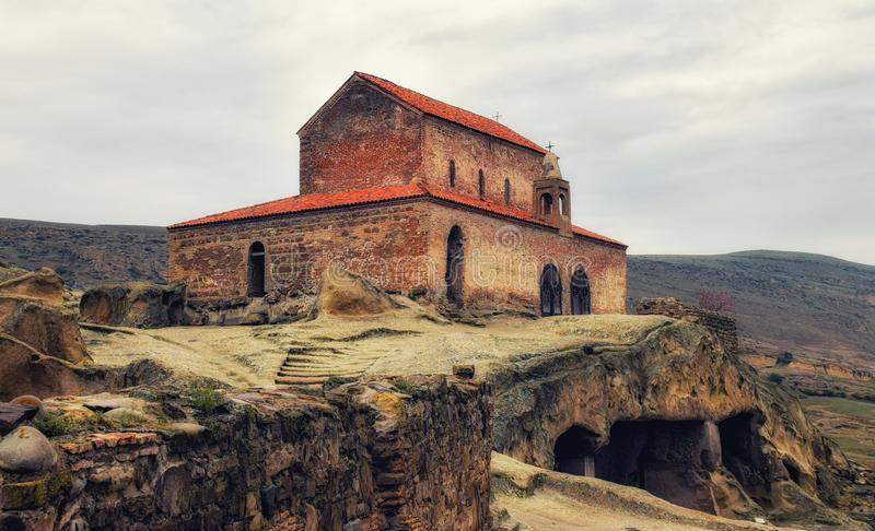 Uplistsikhe, Ancient rock cave city complex with christian basi. Uplistsikhe, Georgia - April 13, 2017 : Uplistsikhe is an ancient rock-hewn town in eastern royalty free stock photos