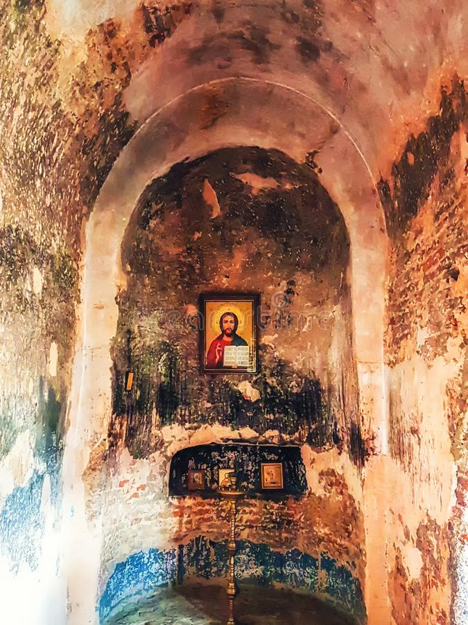 Iconostasis in Christian Basilica in ancient rock-hewn town call. Uplistsikhe, Georgia - April 13, 2017: iconostasis in Christian Basilica in ancient rock-hewn royalty free stock photography