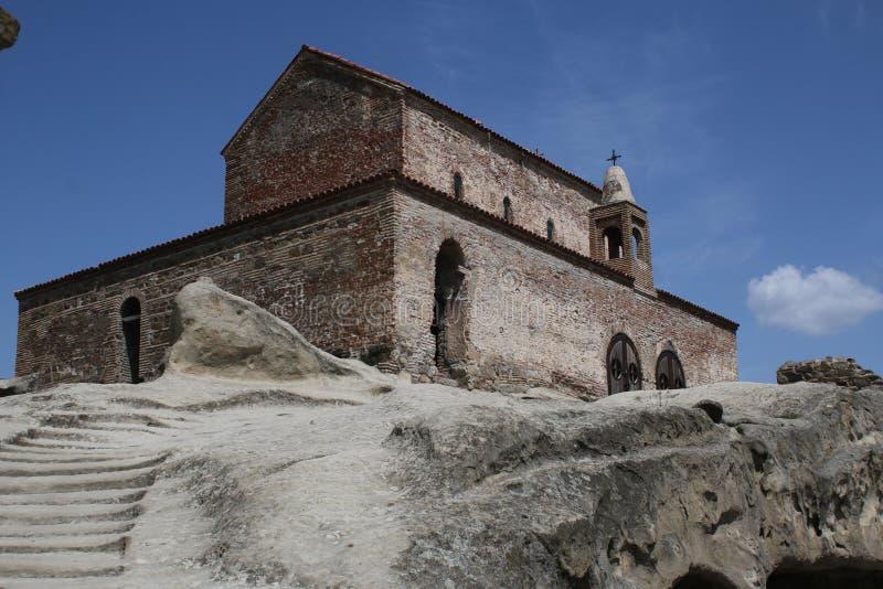 Early christian basilica in the ancient rock-hewn town Uplistsikhe. Uplistsikhe, Georgia - MAY 5, 2017: Early christian St.George's basilica VI сentury stock photography
