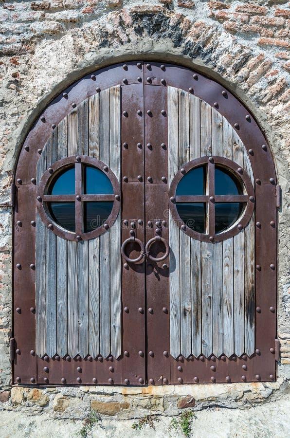 Uplistsikhe in Georgia. Wooden and metal door of Christian Basilica in ancient rock-hewn town called Uplistsikhe in Georgia stock image
