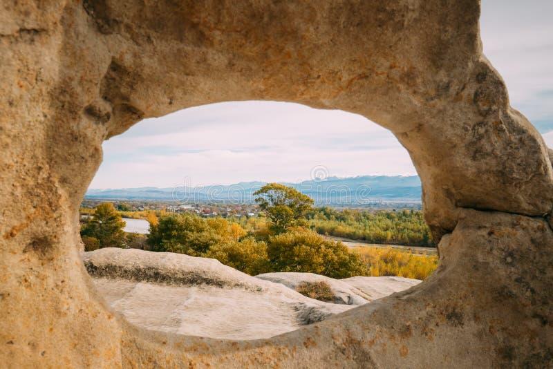 Uplistsikhe, Shida Kartli Region, Georgia. View Of Kvakhvreli Ci. Tyscape Through Natural Arch In Famous Landmark. Ancient Rock-hewn Town In Eastern Georgia royalty free stock photo