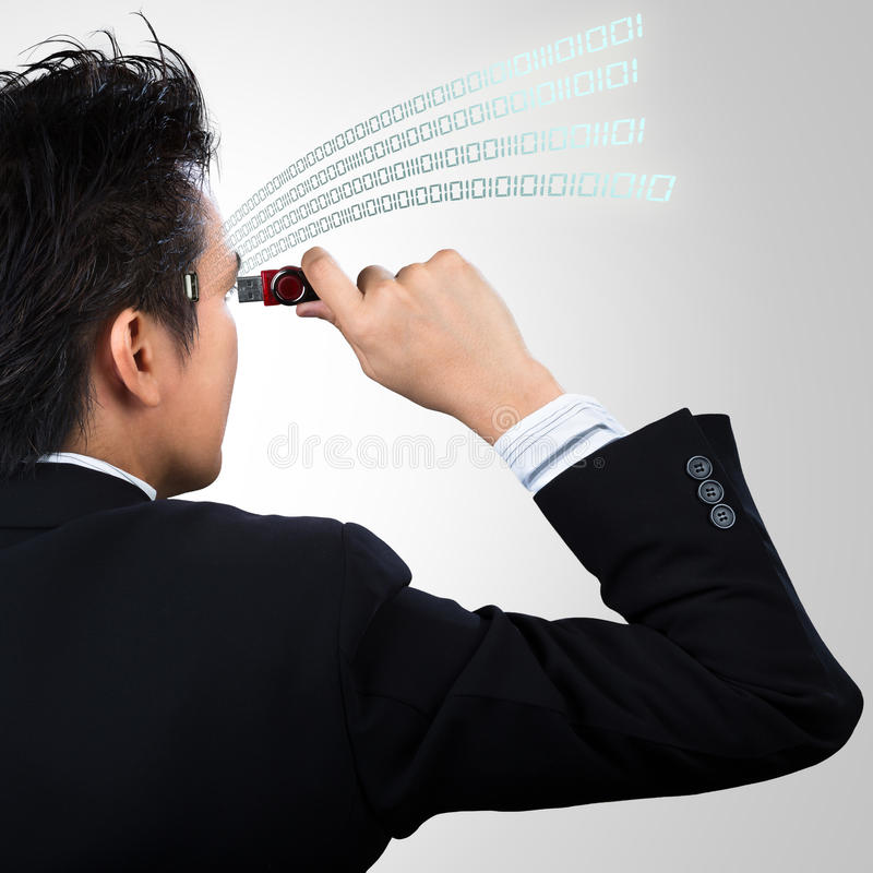 Uploading. Concept of uploading data to businessman royalty free stock photography