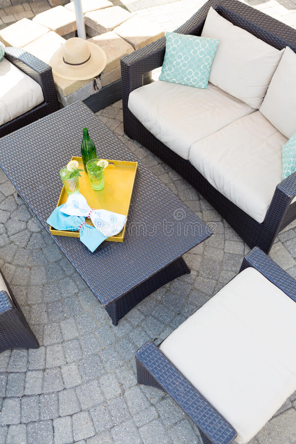 Upmarket outdoor patio with garden furniture stock photography