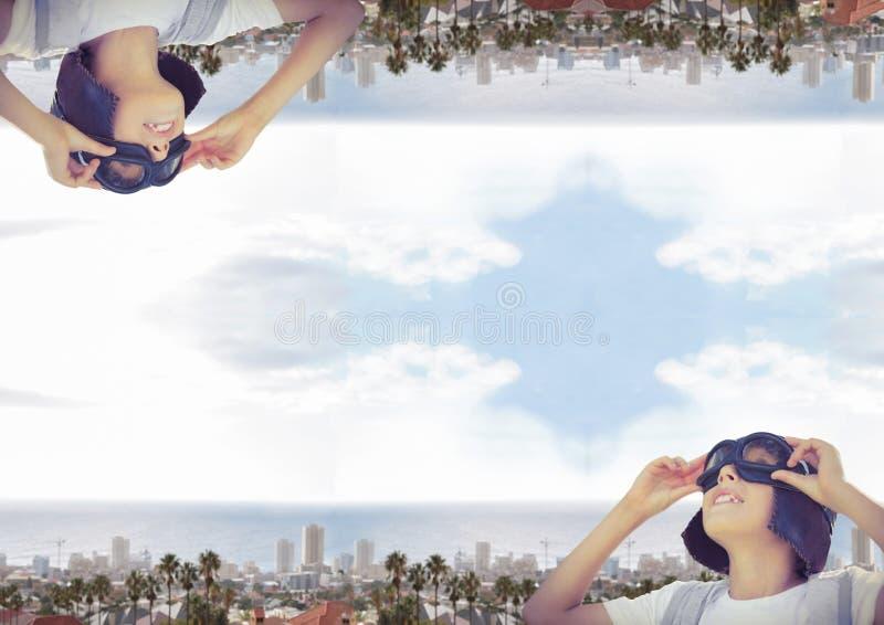 upp för sida stad ner med havet pojke arkivbild