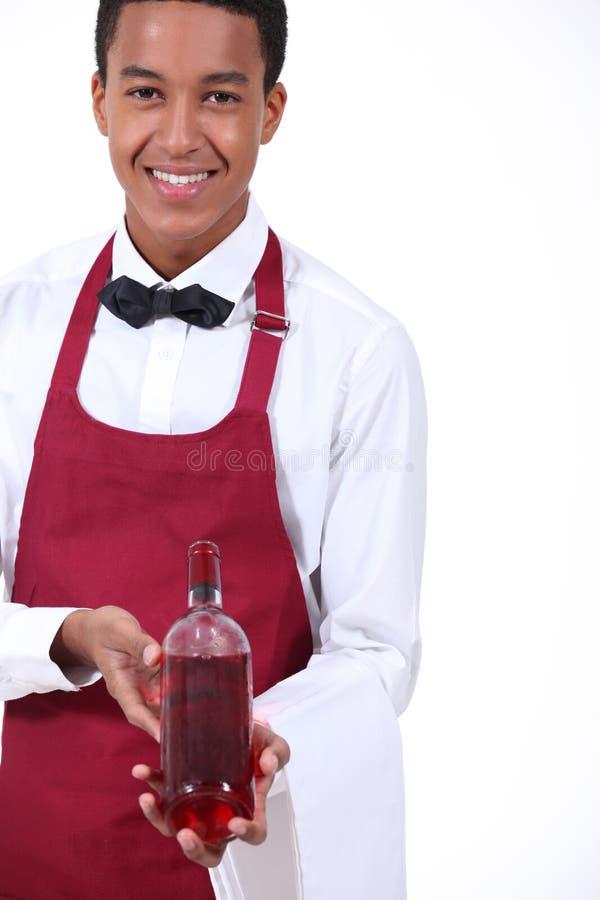 Uppassare med vin royaltyfri foto