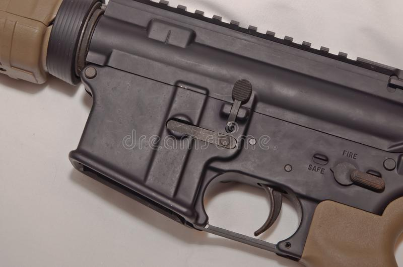 The upper of a black and brown 223 caliber AR-15 rifle. On a white background without an inserted magazine stock images