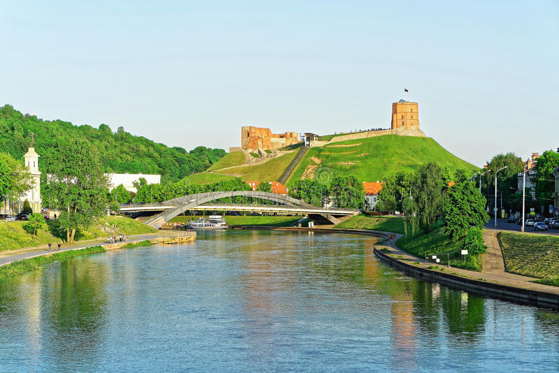 Upper Castle and Neris River at the Mindaugas Bridge. Vilnius, Lithuania. Gediminas Tower is also called as Upper Castle. Lithuania is one of the Baltic royalty free stock photo