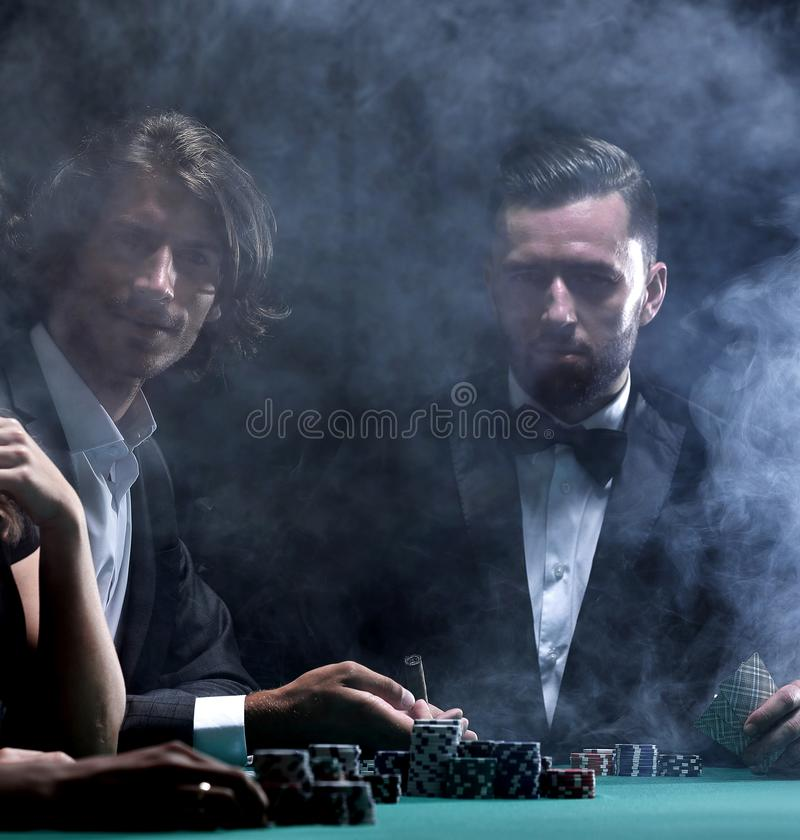 Upper class friends gambling in a casino. Four people roasting in a roulette in a casino stock photo