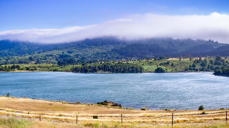 Upper Crystal Springs Reservoir,  part of the San Mateo Creek watershed and Santa Cruz mountains covered with clouds visible in. The background; San Mateo, San stock photo