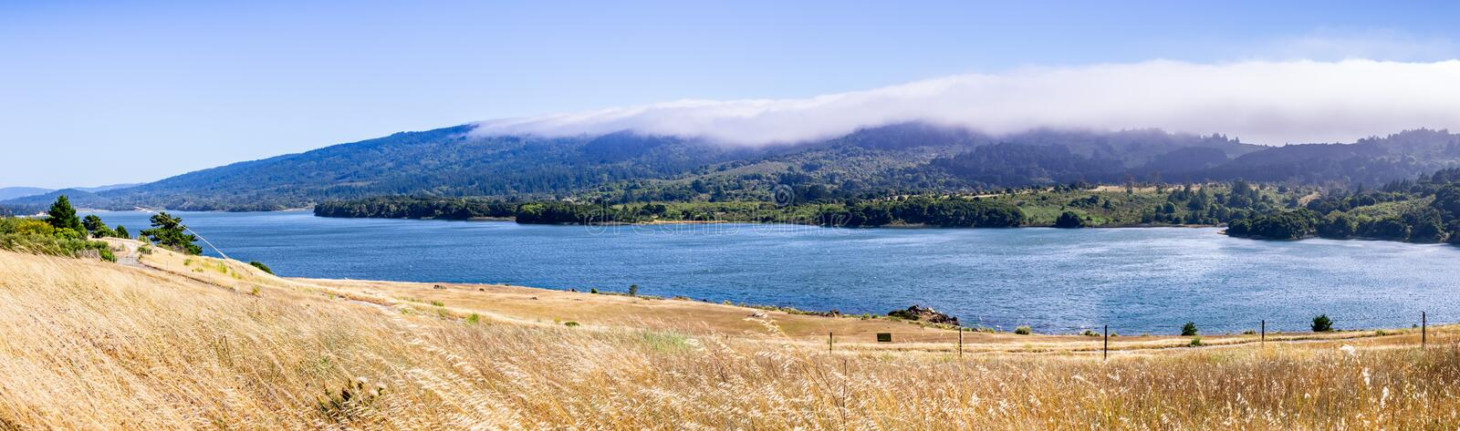 Upper Crystal Springs Reservoir,  part of the San Mateo Creek watershed and Santa Cruz mountains covered with clouds visible in. The background; San Mateo, San royalty free stock image