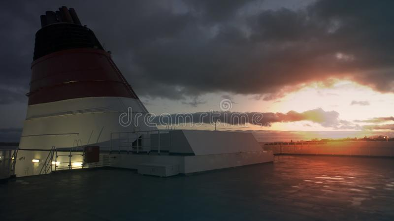 The upper deck of the steamer. Low key photo, sunset, light effect, selective focus. Sea voyage, cruise royalty free stock image