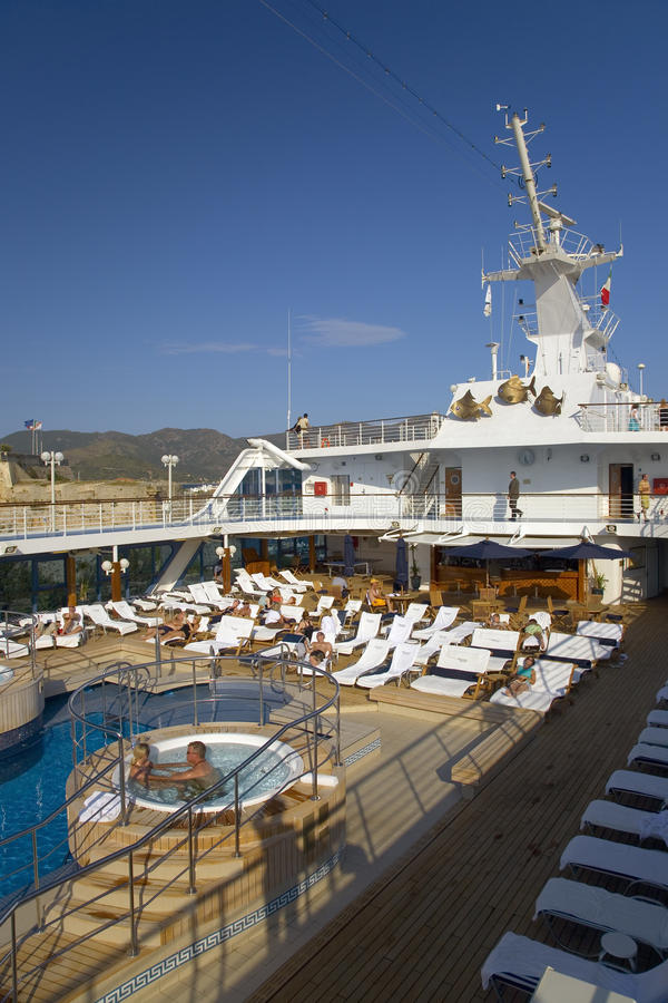 Upper deck swimming pool of Insignia Oceania Cruise ship as it cruises Mediterranean Ocean, Europe royalty free stock photography