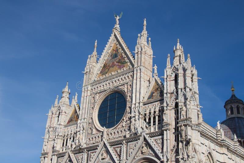 Upper facade detail of Duomo di Siena or Metropolitan Cathedral of Santa Maria Assunta. Tuscany. Italy. royalty free stock photos