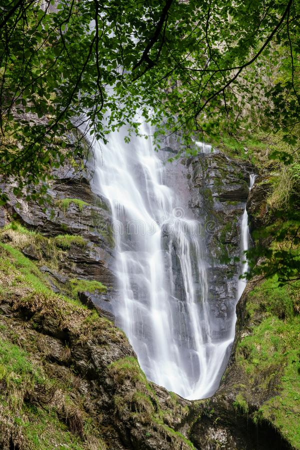 Water falling into midway pool at waterfall of Pistyll Rhaeadr in Wales. Upper flow of water into mid level pool at waterfall of Pistyll Rhaeadr falls in Wales stock photos
