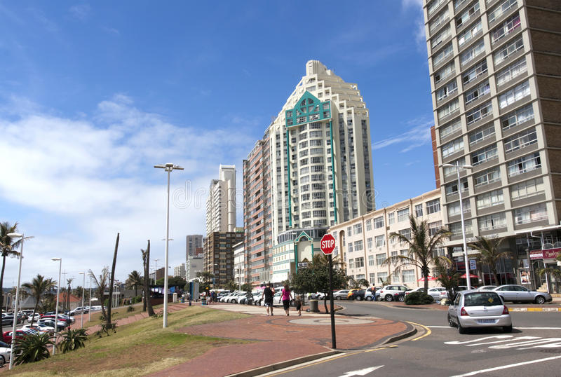 Upper Marine Parade Lined with Hotels at Durban, South Africa. DURBAN, SOUTH AFRICA - DECEMBER 28, 2014: Many unknown people and residential and commercial stock images