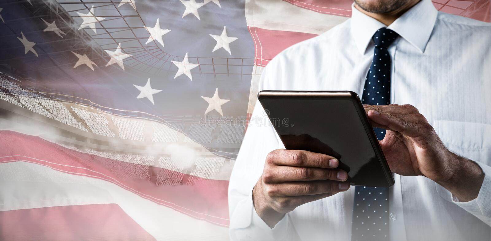 Composite image of upper mid-section of man using a tablet stock images