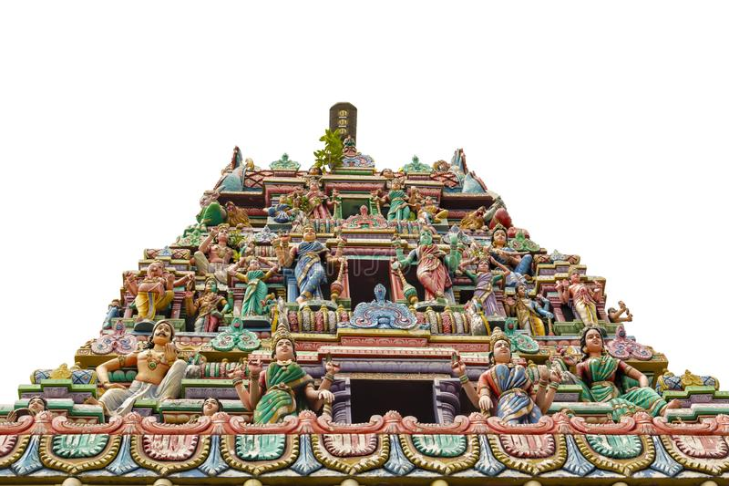 Upper part of the Buddhist temple with figures of deities and mythical heroes isolated. On white background stock photo