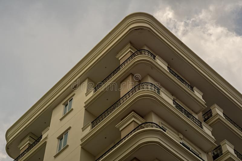 The upper part of a building in Thailand. Shot from a public place stock image