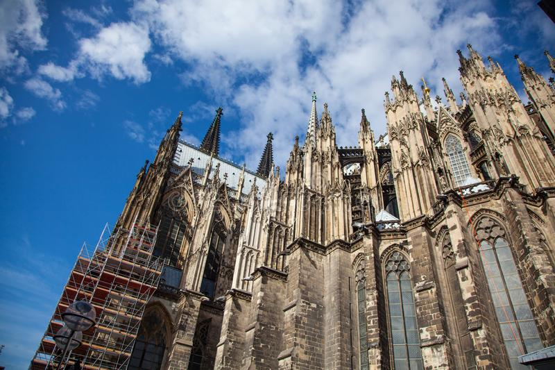 Upper part of Cologne Cathedral on blue sky. Cologne, dome of cologne royalty free stock photo