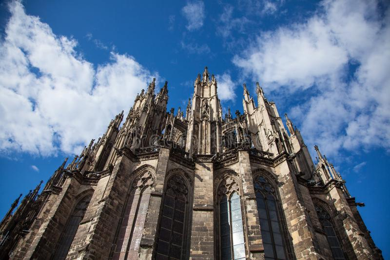Upper part of Cologne Cathedral on blue sky. Germany. Upper part of Cologne Cathedral on blue sky.Dom og Cologne.Germany royalty free stock photography