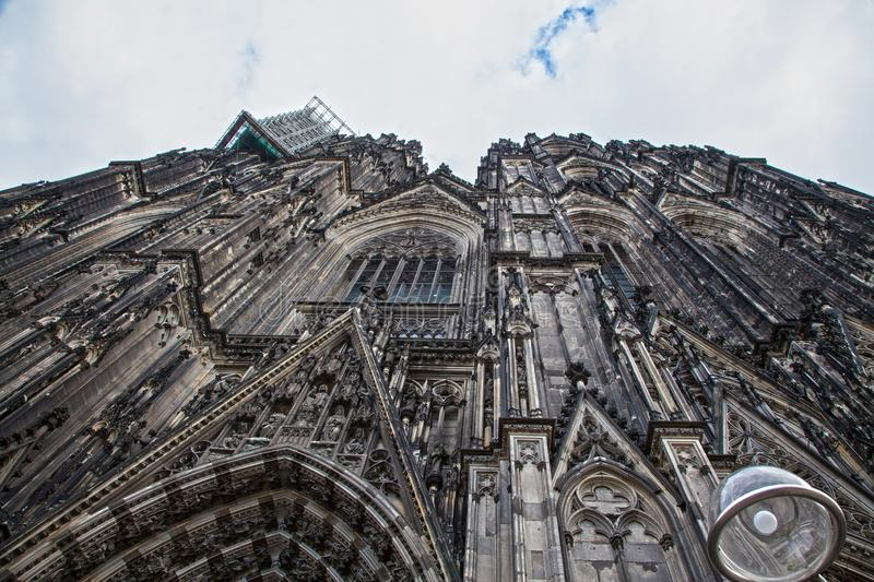 Upper part of Cologne Cathedral on blue sky. Cologne, dome of cologne royalty free stock photography