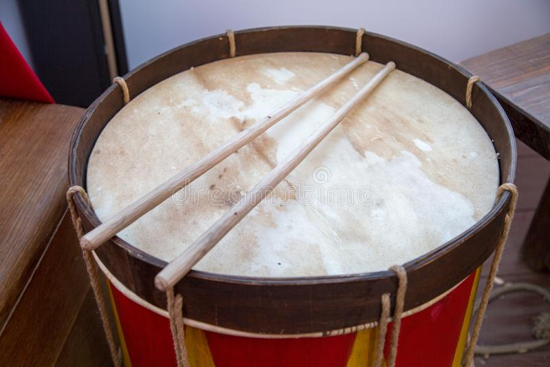 The upper part of the drum with wooden sticks. Folk wooden art.  Leisure Hobbies stock image