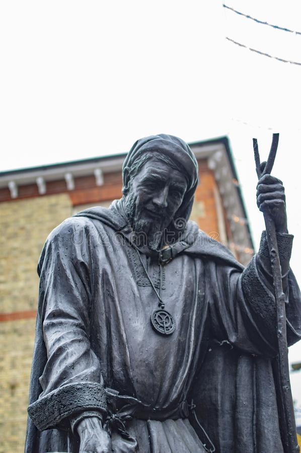 The upper part of Geoffrey Chaucer statue in kent canterbury. With hands holding something stock image