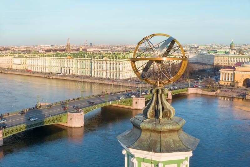 The upper part of the Kunstkamera building with an armillary sphere. View of the Neva River, View of the Palace Bridge, the. Hermitage Winter Palace. Evening royalty free stock images
