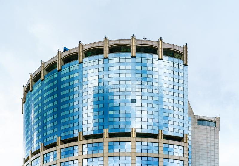 The upper part of the modern skyscraper.  royalty free stock images