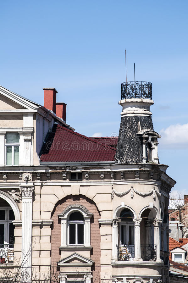 Upper part of the old town house. On blue sky background royalty free stock photo