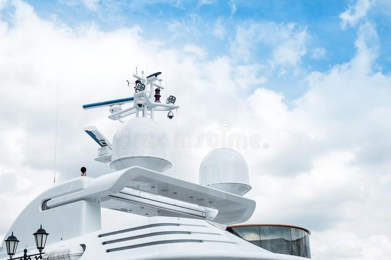 The upper part is the roof of a luxurious yacht against a cloudy sky. The upper part is the roof of a luxurious white yacht against a cloudy sky royalty free stock photo