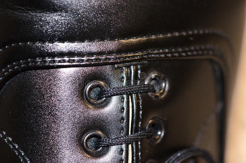 Upper part of shoe. Upper part of show with laces and stitching royalty free stock image