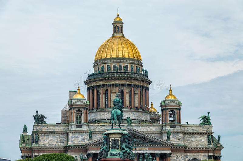 The upper part of St. Isaac cathedral and The Monument to Nicholas I. Saint Petersburg, Russia. The upper part of St. Isaac cathedral and The Monument to stock photography