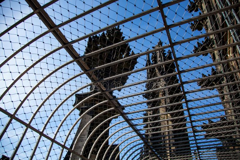 The upper part of the tower of Cologne Cathedral, observation deck. Panoramic view of the city through a metal fence royalty free stock photography