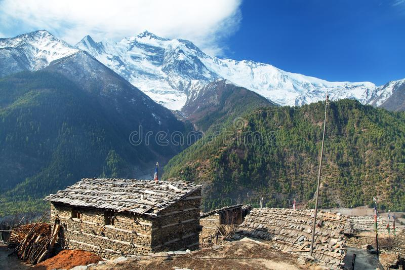 Upper Pisang village and Annapurna 2 II royalty free stock photos
