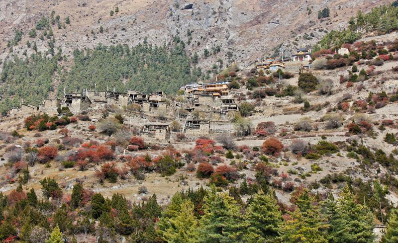 Upper Pisang / Village in Nepal on steep hill royalty free stock photos