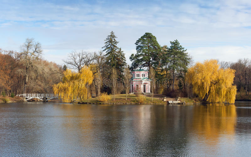 Upper pond in park Sofiyivka. Uman city, Central Ukraine. Upper pond and Pink Pavilion on Island of Anti-Circe in park Sofiyivka (National dendrological park of stock photography