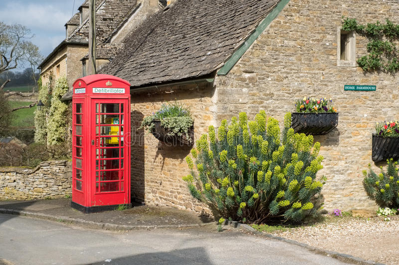 UPPER SLAUGHTER, GLOUCESTERSHIRE/UK - MARCH 24 : Defibrillator i. N an Old Phone Box in Upper Slaughter Village in the Cotswolds in Gloucestershire on March 24 stock photos