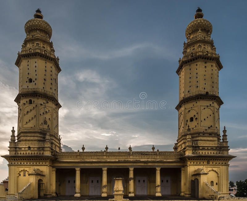 Upper structure of Jamia Masjid mosque, Mysore, India. Mysore, India - October 26, 2013: Upper structure with two minarets of Jamia Masjid mosque on stock image