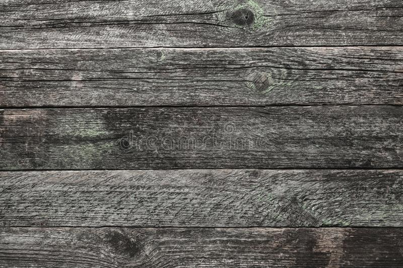 Upper, top view of a light gray, time aged wooden blackboard background in old royalty free stock photos