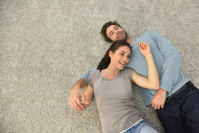 Upper view of couple lying on carpet floor. Upper view of couple laying on carpet stock photos