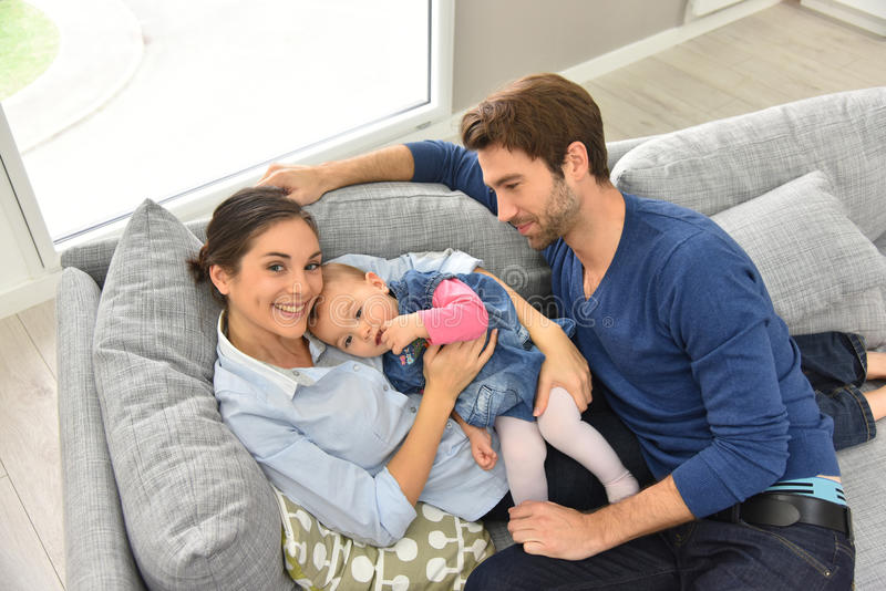 Upper view of happy young family. Upper view of young family relaxing in sofa royalty free stock photos