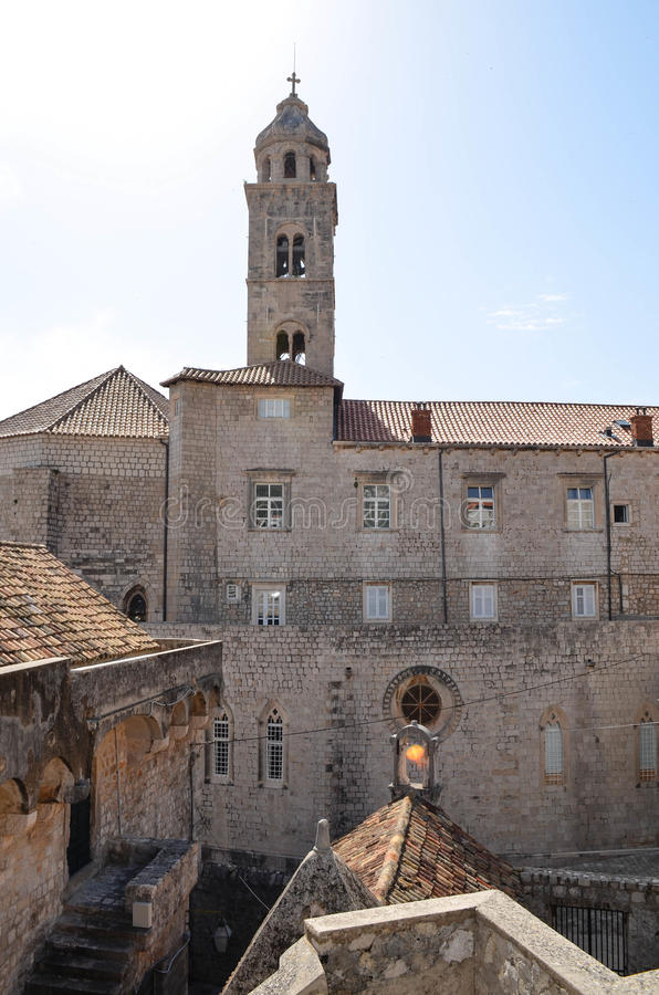 Upper View of old palace with tipical windows in Dubrovnik Old Town. Upper View of old palace with tipical windows i Dubrovnik ,Croatia Old Town with sea and royalty free stock photo